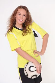 Free Beautiful Football Girl In Yellow T-shit And Ball Stock Photography - 16044752