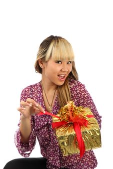 Free The Young Girl About A Gift By A Box Royalty Free Stock Image - 16046106