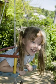 Cheerful Girl On A Swing Stock Images