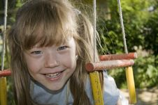 Free Cheerful Girl On A Swing Stock Photos - 16048833