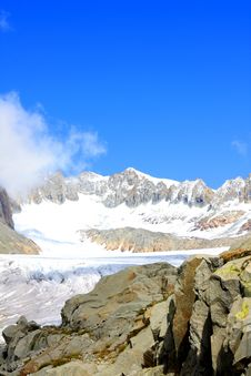 Free Glacier With Snow Capped Mountains Royalty Free Stock Photo - 16052365