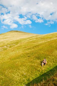 Hiker Resting On Mountain Slope Royalty Free Stock Photo