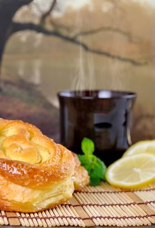 Free Breakfast With Sweet Buns, Lemon And Tea Royalty Free Stock Image - 16054066