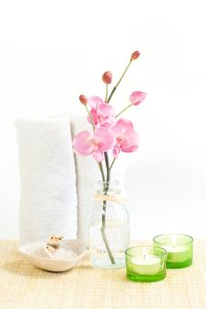 Composition Of Pink Orchid, Towel And Two Candles Royalty Free Stock Photo