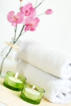 Composition Of Pink Orchid, Towel And Two Candles Royalty Free Stock Images