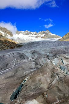 Glacier With A Crack And Snowy Mountains Stock Images