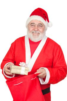 Free Santa Claus Getting A Gift From His Sack Royalty Free Stock Photos - 16057108