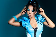 Mulatto Girl DJ Listens Music Stock Photo