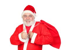 Free Santa Claus With A Full Sack Saying OK Royalty Free Stock Photo - 16057345