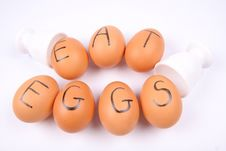 Eggs With An Inscription EAT EGGS Stock Photos