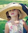 Free Girl Wearing Too Big Hat Stock Image - 16061171
