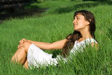Pretty Young Woman Dreaming On The Grass