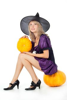 Witch Sitting On A Pumpkin, Holding A Stock Image