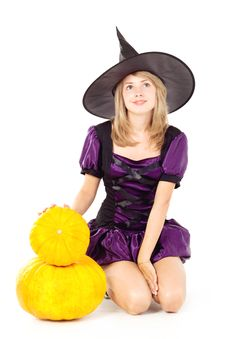 Witch Sitting On A Pumpkin Stock Photos