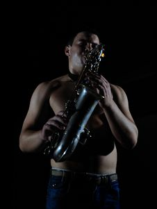 Young Handsome Man Playing Music On Saxophone Royalty Free Stock Images