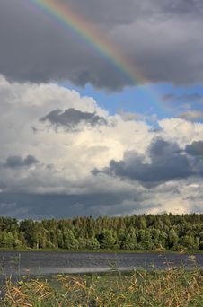 Rainbow Over Lake Stock Photography