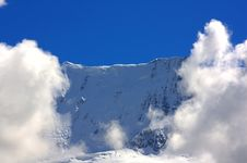 Free Mountain Top Flanked By Clouds Stock Image - 16064301