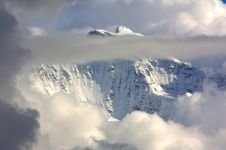 Free Snowy Mountain Top With Clouds Royalty Free Stock Image - 16064846