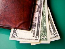 Money On A Wallet Royalty Free Stock Images