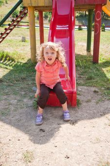 Free Little Girl On The Slide Royalty Free Stock Photography - 16066297
