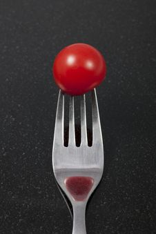 Free Tomato On A Fork With Reflection Stock Images - 16069284