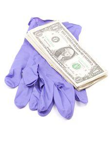 Free Dollar Bills On Forensic Gloves, White Background Stock Images - 16069334