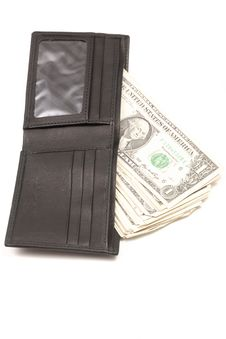 Brown Leather Wallet With Dollar Bills Stock Image
