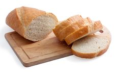 Free A Long Loaf Sliced On A Cutting Board Stock Photos - 16070313