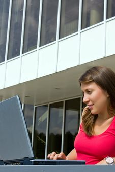 Beautiful College Student Working On Her Laptop Royalty Free Stock Photo
