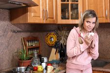 Free Woman With Hot Drink In The Kitchen Stock Image - 16072531