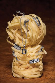 Jewelery On Noodle Rolls Royalty Free Stock Photo