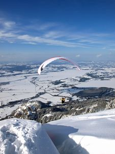 Free Paraglider Flying From A Mountain Into A Valley Royalty Free Stock Photos - 16079388