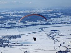 Paraglider Flying Over A Valley In Germany Royalty Free Stock Images