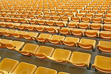 Perspective Of Yellow Seats In Football Stadium Royalty Free Stock Photo
