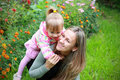 Free Girl With Her Mother In The Garden Royalty Free Stock Photos - 16084458