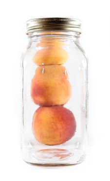 Free Canning Peaches In A Glass Jar Royalty Free Stock Image - 16080696