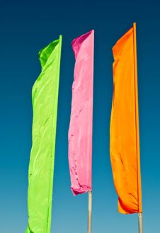 Free Flags - Green, Pink, Orange Against The Blue Sky Royalty Free Stock Photos - 16083278