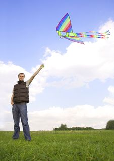 Man Standing And Playing With Kite Stock Images