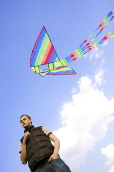 Man Playing With Multicolored Kite Stock Photography