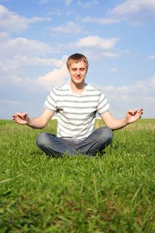 Free Man Sitting On Lawn And Meditating Royalty Free Stock Images - 16084289