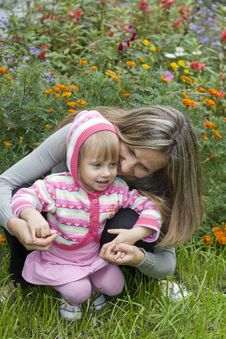 Free Girl With Her Mother In The Garden Royalty Free Stock Photo - 16084515