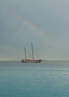 Free Rainbow With Sailing Boat On A Flat Sea Stock Photos - 16089743