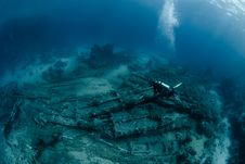 Free Diver Over Underwater Wreckage Royalty Free Stock Image - 16089816