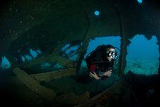 Female Scuba Diver Exploring Ship Wreck Royalty Free Stock Photos
