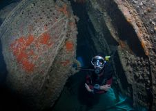 Female Scuba Diver Exploring Ship Wreck Stock Images