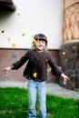 Free Adorable Little Girl Plays With Yellow Leaves Royalty Free Stock Photo - 16090575