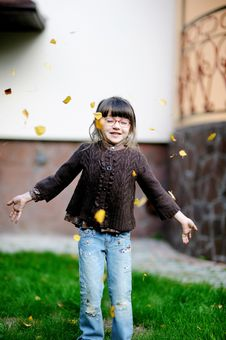 Adorable Little Girl Plays With Yellow Leaves Royalty Free Stock Photo