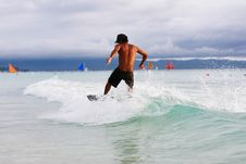 Skimboarder In Action Stock Images