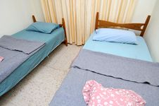 Free Twin Beds In Simple Motel Room Royalty Free Stock Photography - 16099757