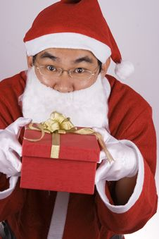 Asian Santa Claus With Present Royalty Free Stock Photography